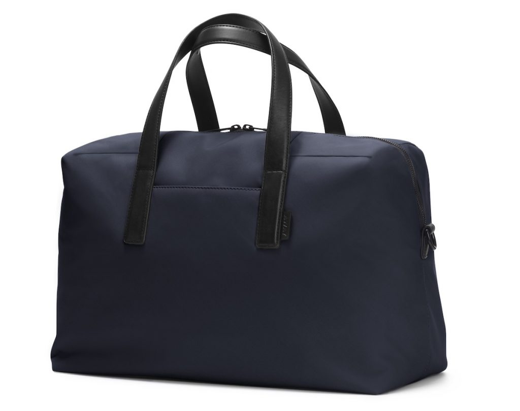 Large carry on bag in Navy by Away