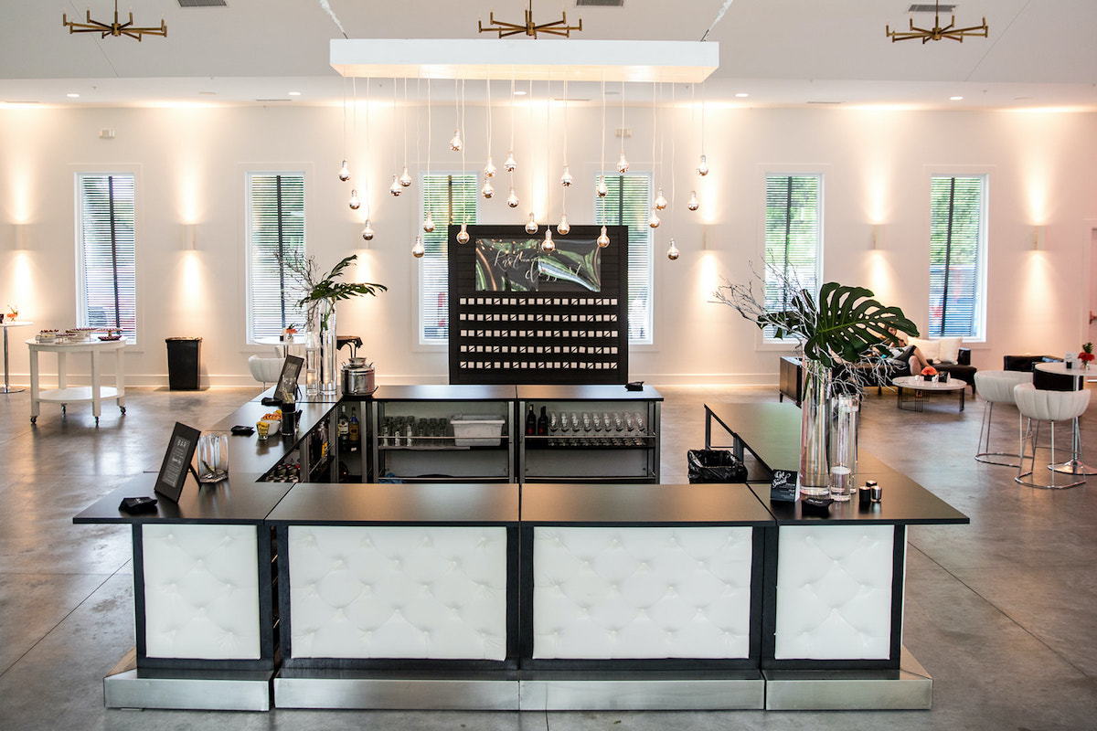 Black and white tufted custom bar for wedding by BeThings Rentals