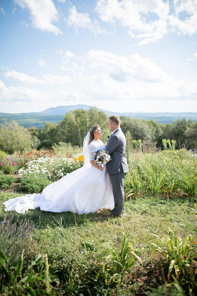 Bride and groom hold outdoor mountain wedding during a pandemic