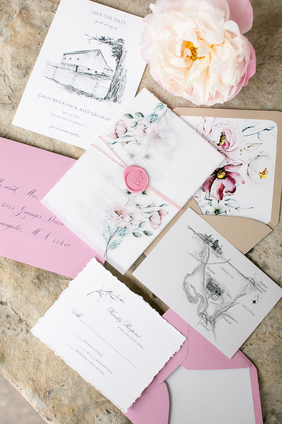 Pink, white, and floral wedding stationery