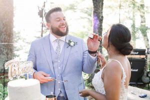Groom feeds bride cake after intimate wedding ceremony