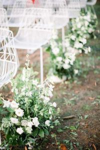 White flower and greenery aisle decor