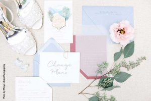 Blue, white, and pink wedding invitations