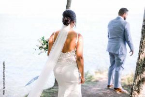 Wedding first look by lake