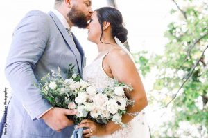 Groom in blue suit shares first look with bride