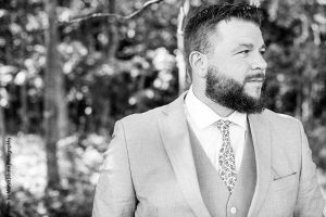 Groom poses for photo before wedding