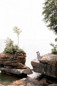 Couple poses for photo at Madeline Island rocks