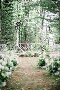 White geometric wedding arch