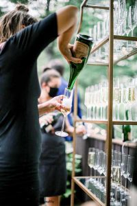 Bartender pours champagne before wedding