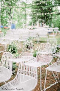 Modern white chairs for intimate wedding ceremony