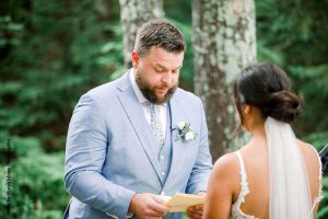 Groom reads vows at intimate wedding
