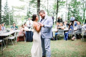 Bride and groom share first dance at outdoor reception