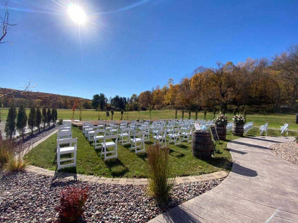 Ceremony at barn wedding venu