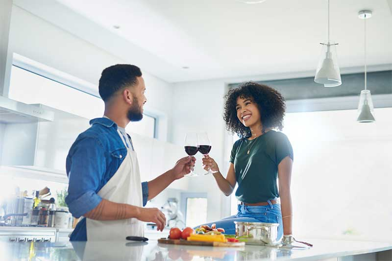 Couples cooks in kitchen for at-home date night idea