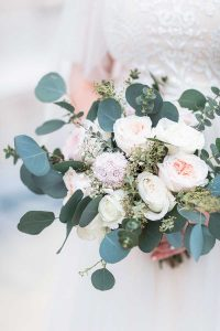 Winter wedding bouquet with white roses and eucalyptus