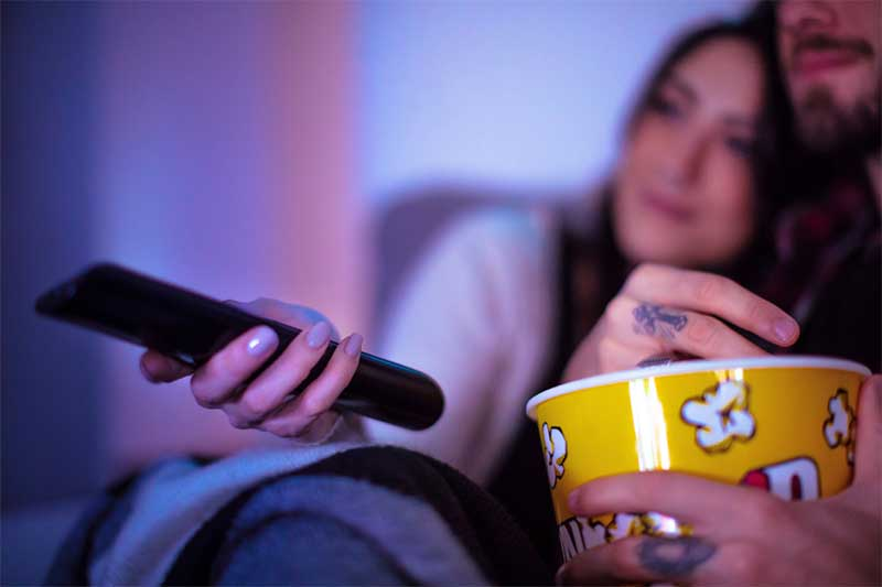 Couples watches movie for at-home date night idea