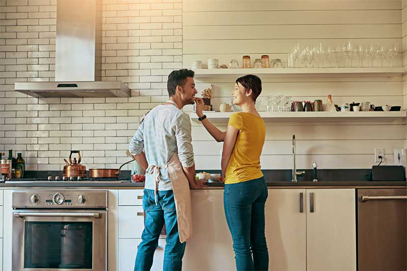 Couples makes meal at home
