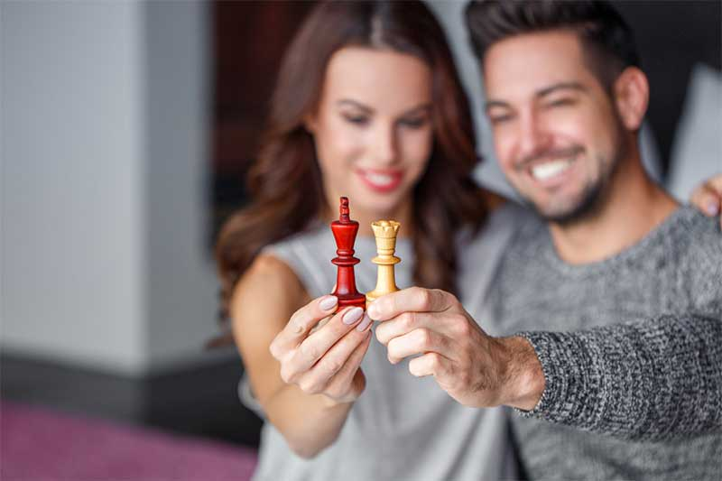 Couple holds chess pieces
