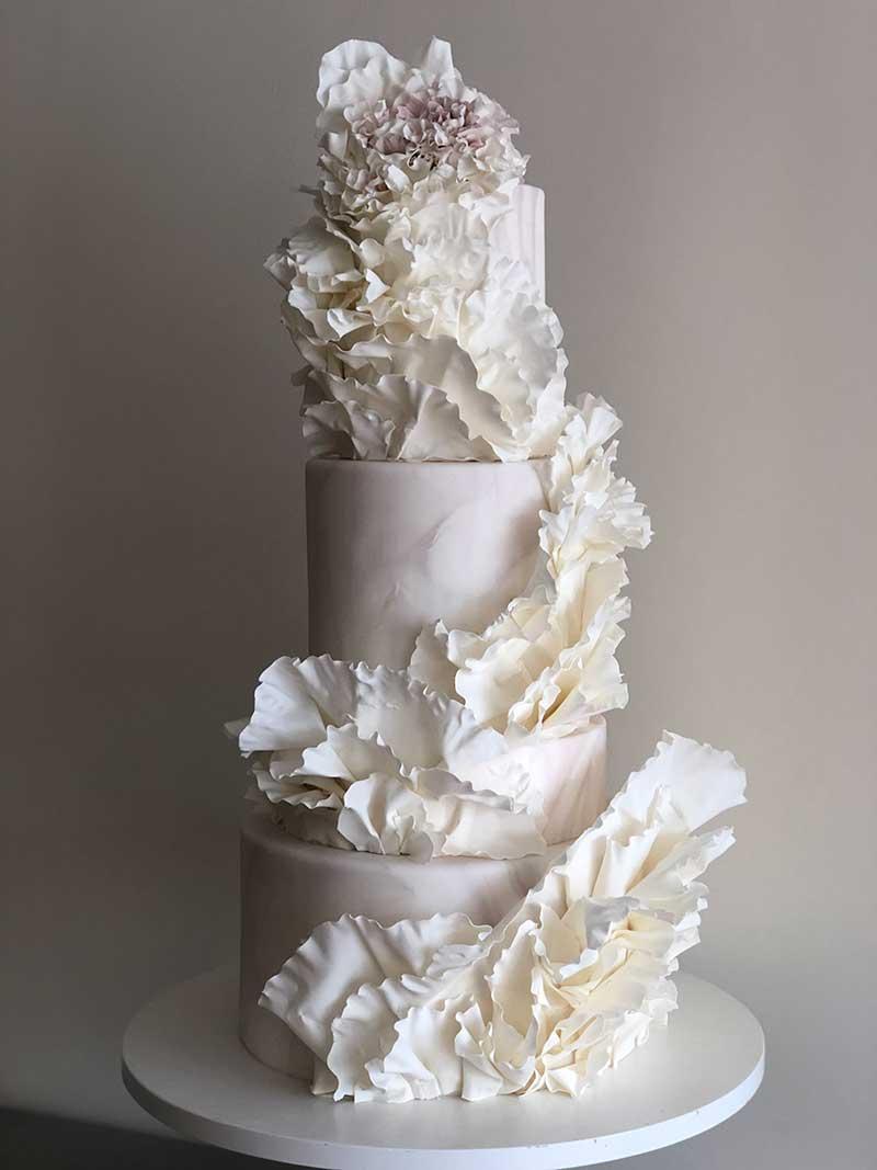 Intricate modern white wedding cakes