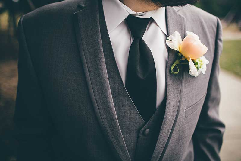 Gray tuxedo with yellow and white boutonnière