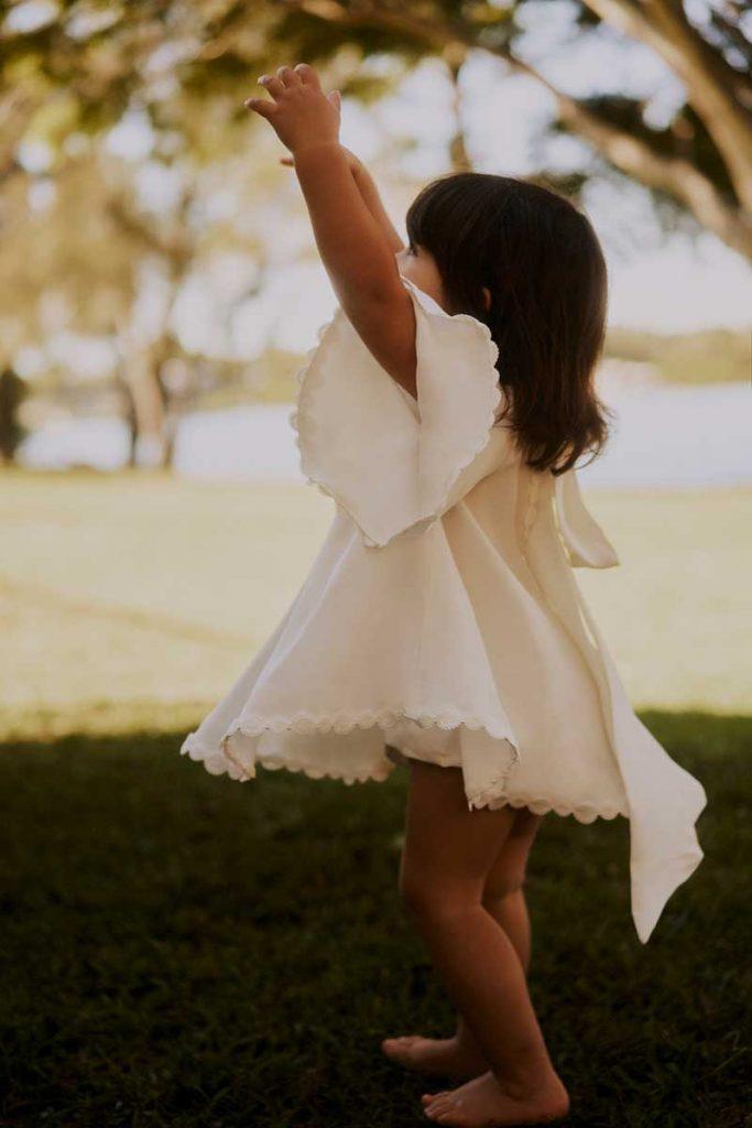 Flower girl in fashionable dress