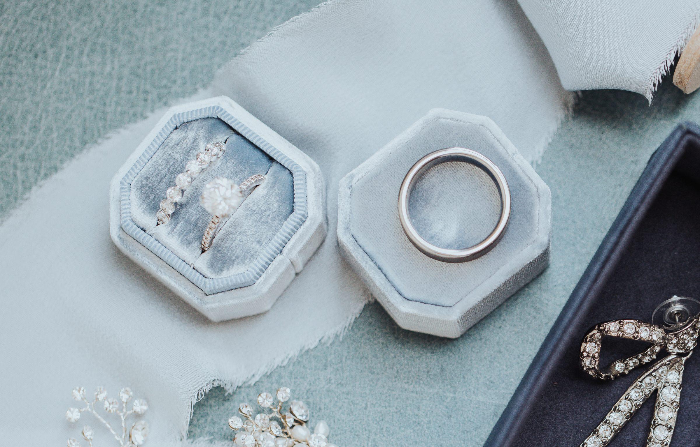 Round engagement ring shapes in blue velvet ring box