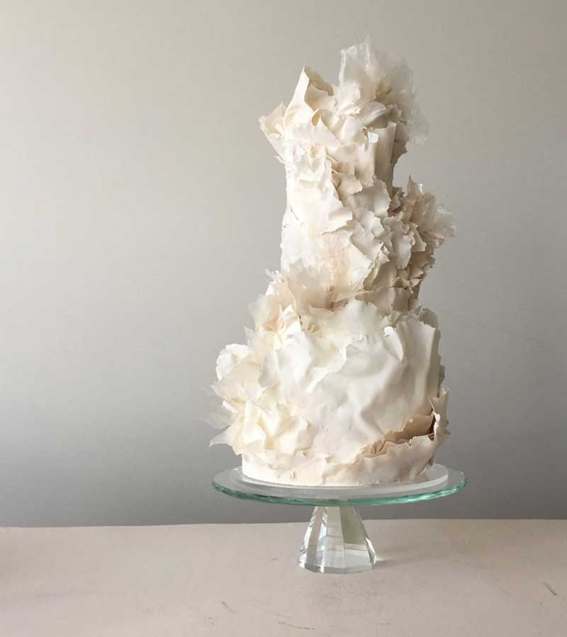 Modern white wedding cake with with sugar flowers
