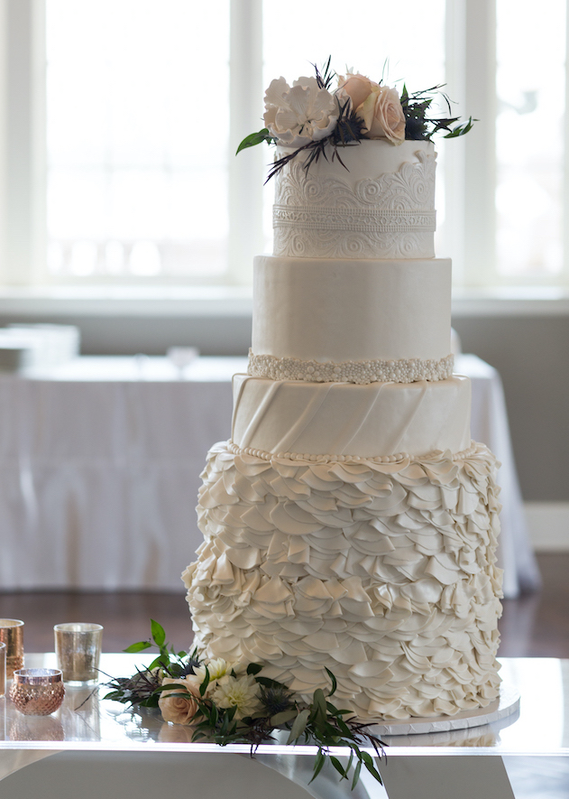 4-tier intricate white wedding cake