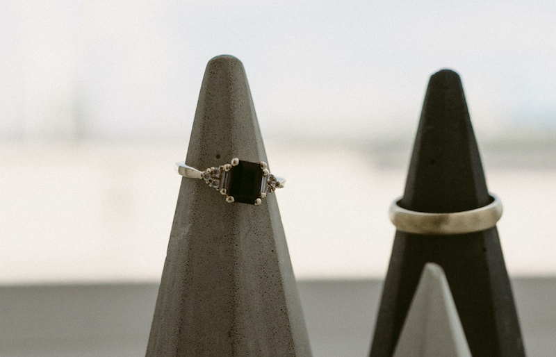 Black engagement ring emerald shape and gold wedding ring