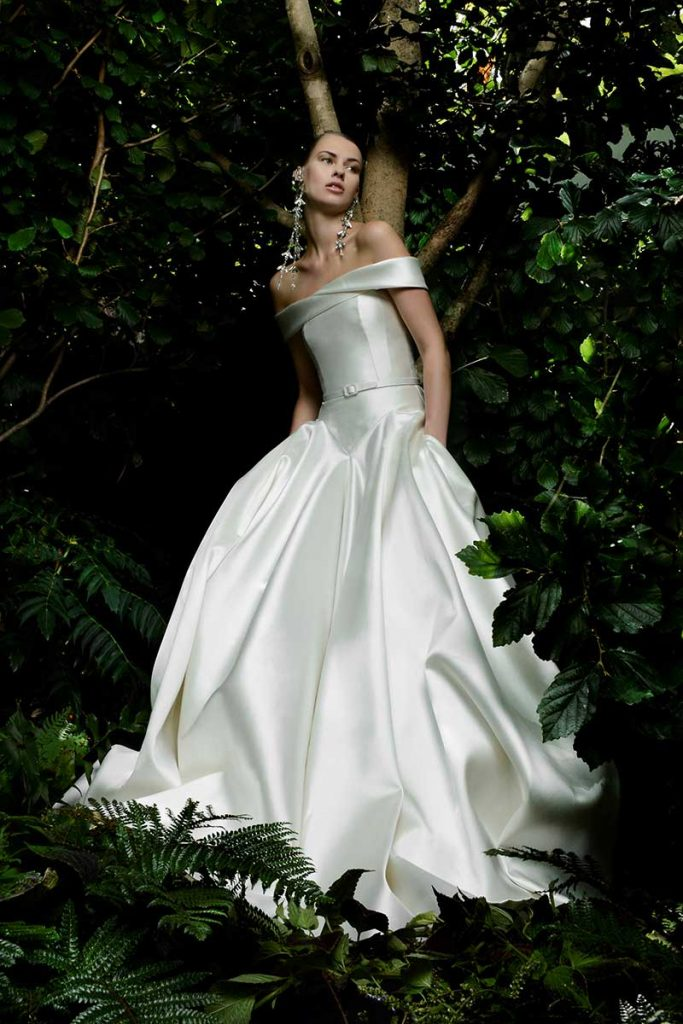 Sleek and classic wedding gown with portrait neckline