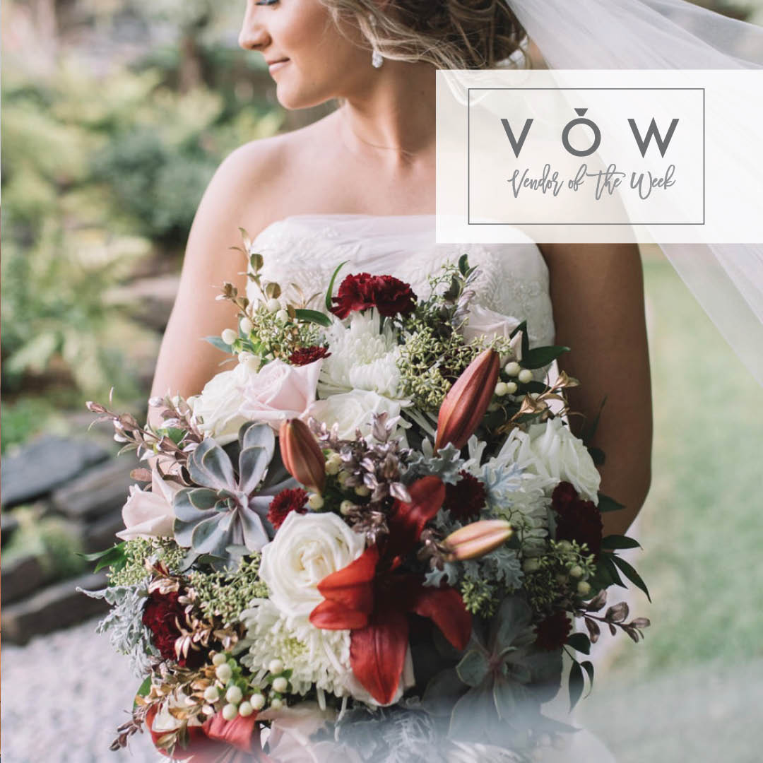Bride with floral bouquet from Renning's Flowers