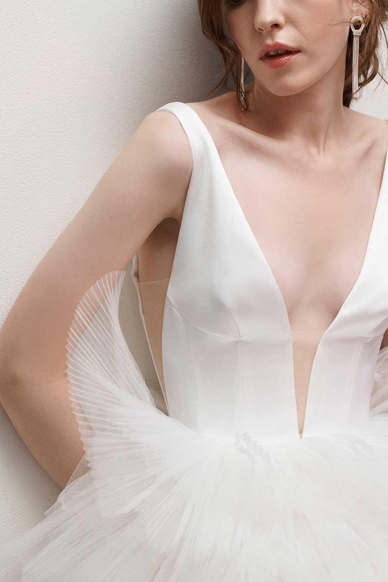 Deep v wedding dress neckline by Rita Vinieris