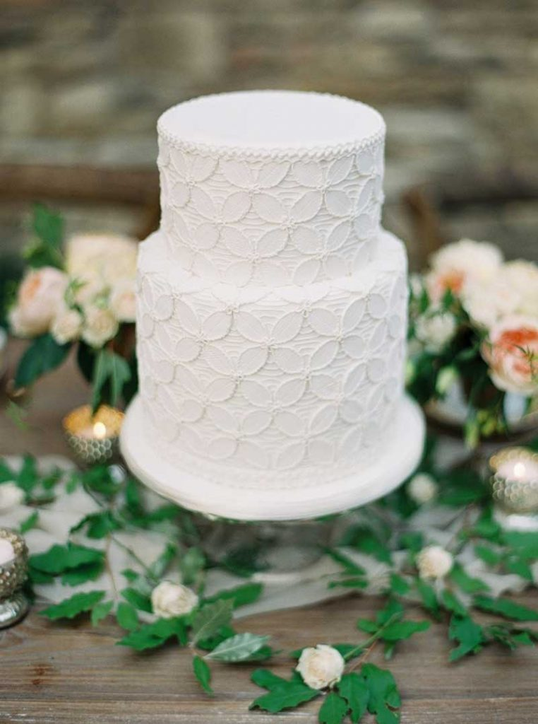 Piped lace white wedding cake