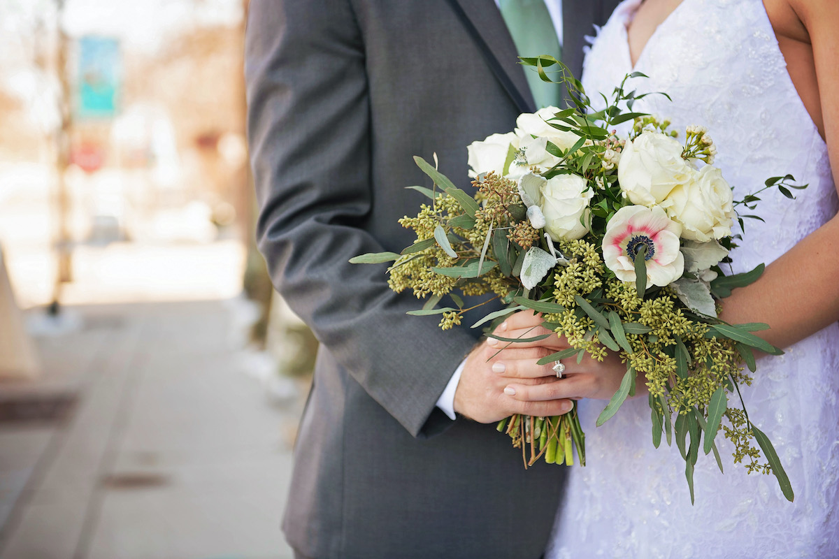 Winter wedding bouquet with roses and anenomes