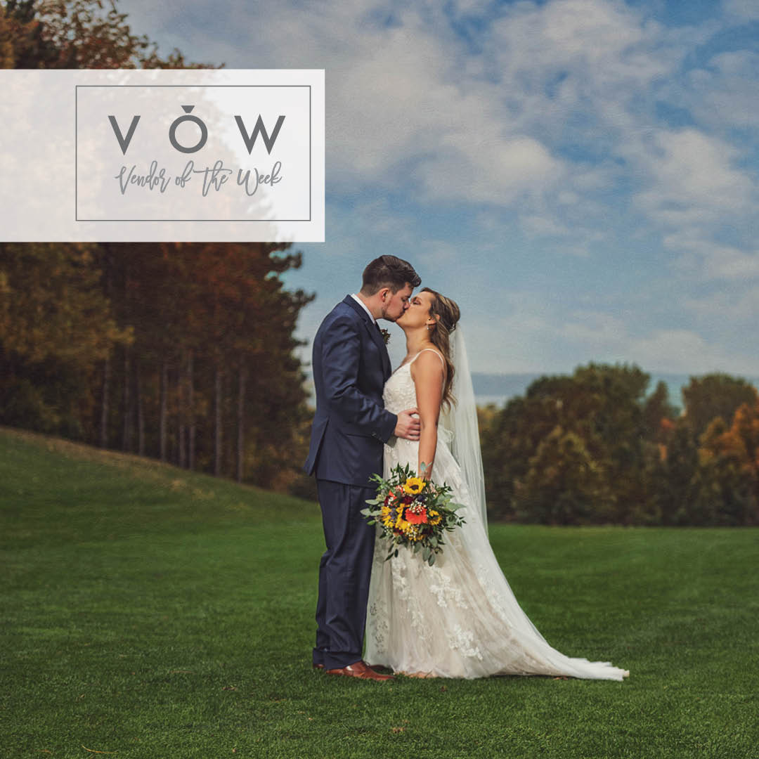 Bride and groom kiss on golf course at fall wedding by Chad and Megan Photography