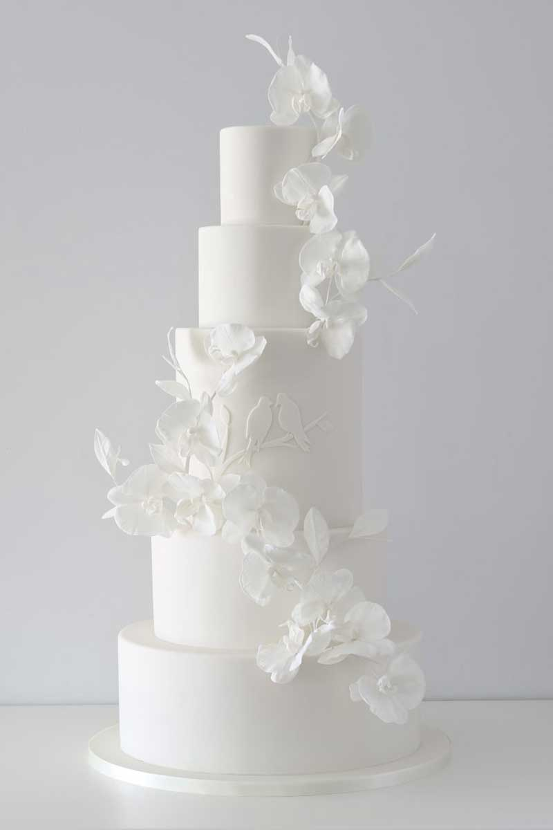 White wedding cake with orchid sugar flowers