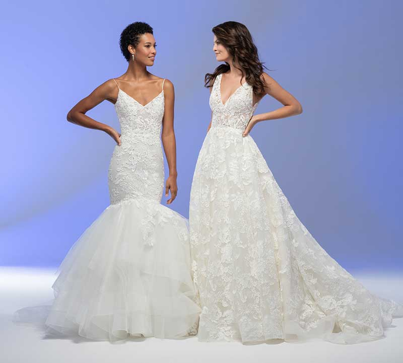 Women model two bridal gowns; 1 that is a mermaid skirt and the other that is fit and flare