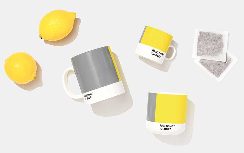Pantone Color of the Year 2021 gray and yellow coffee cups and lemons