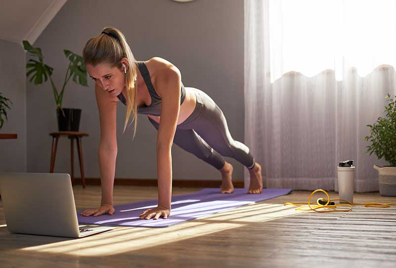 Woman participates in virtual workout class