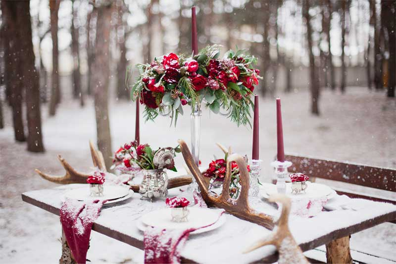 Red and white outdoor winter wedding table