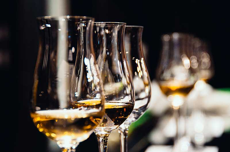 Wine and whiskey served at wedding