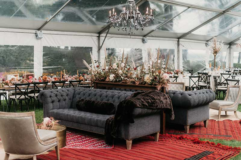 Wedding lounge with red carpet and black couches