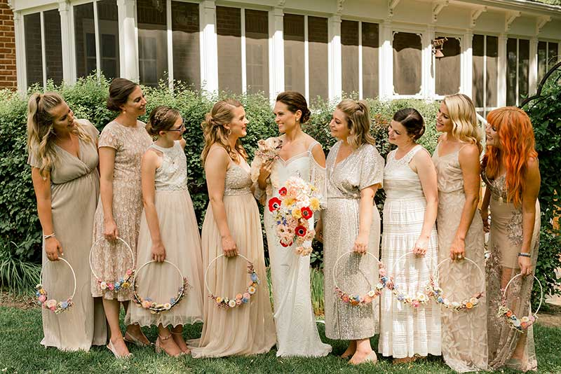 Bridesmaids in tan and white boho dresses