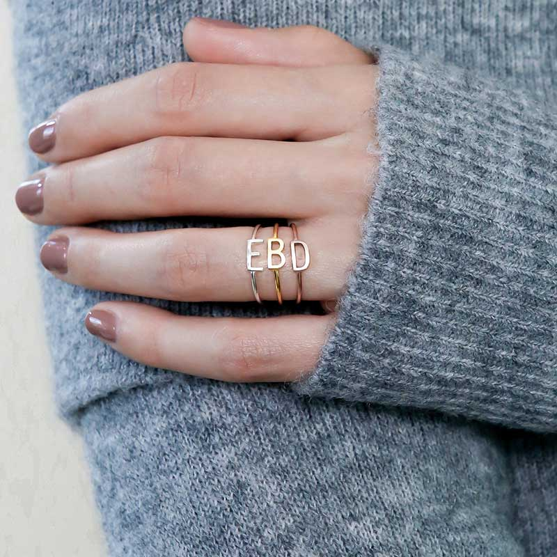 Gold ring with letter as Valentine's gift