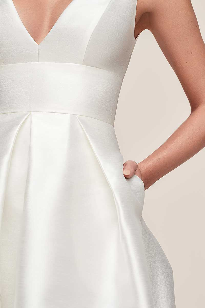 Empire waist wedding dress with pockets