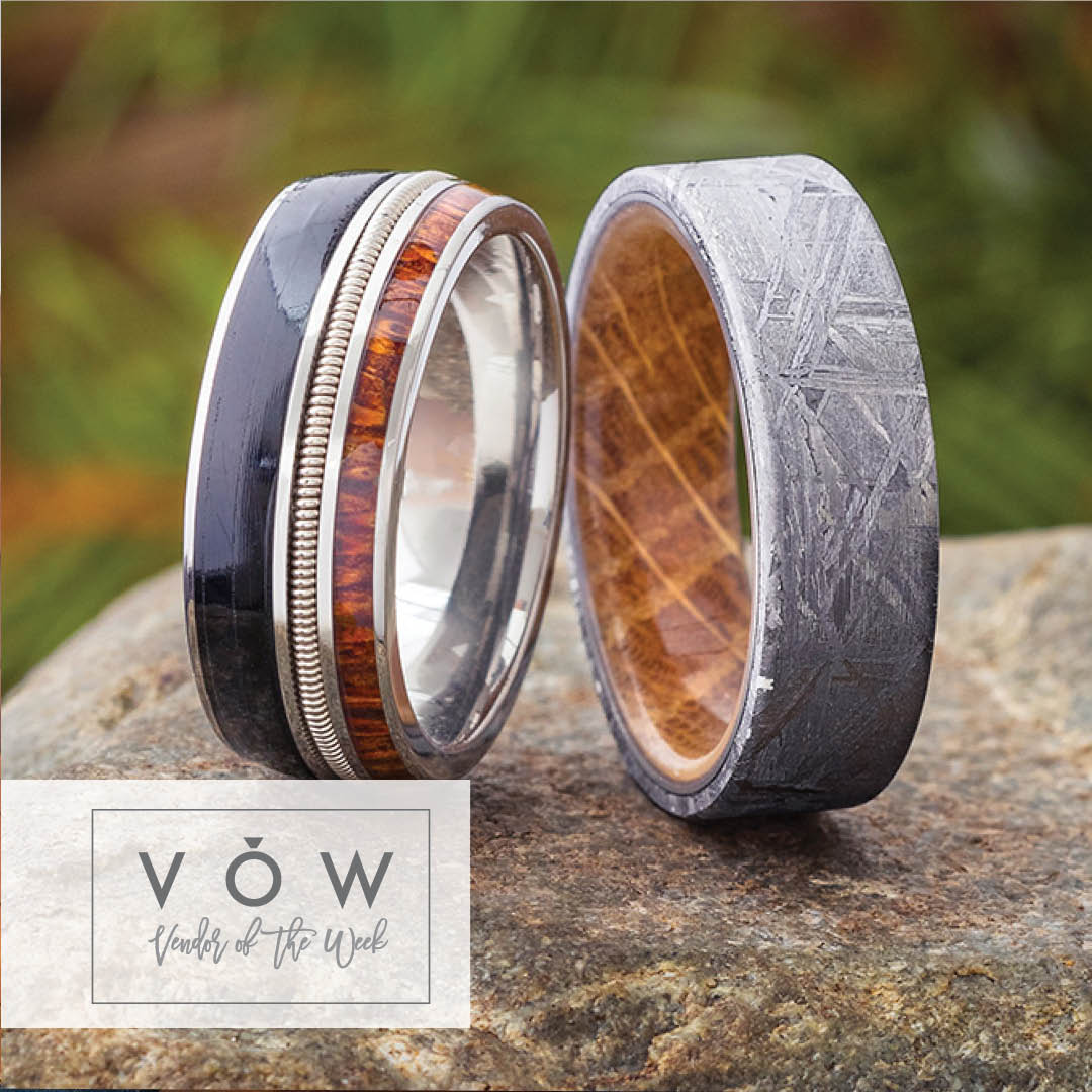 Two custom wedding bands made with wood and meteorite