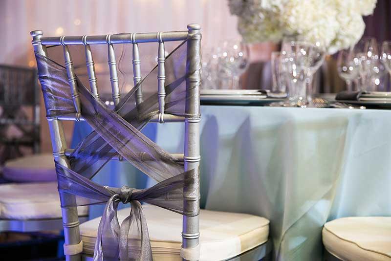 Gold chivari wedding chairs with gray bow