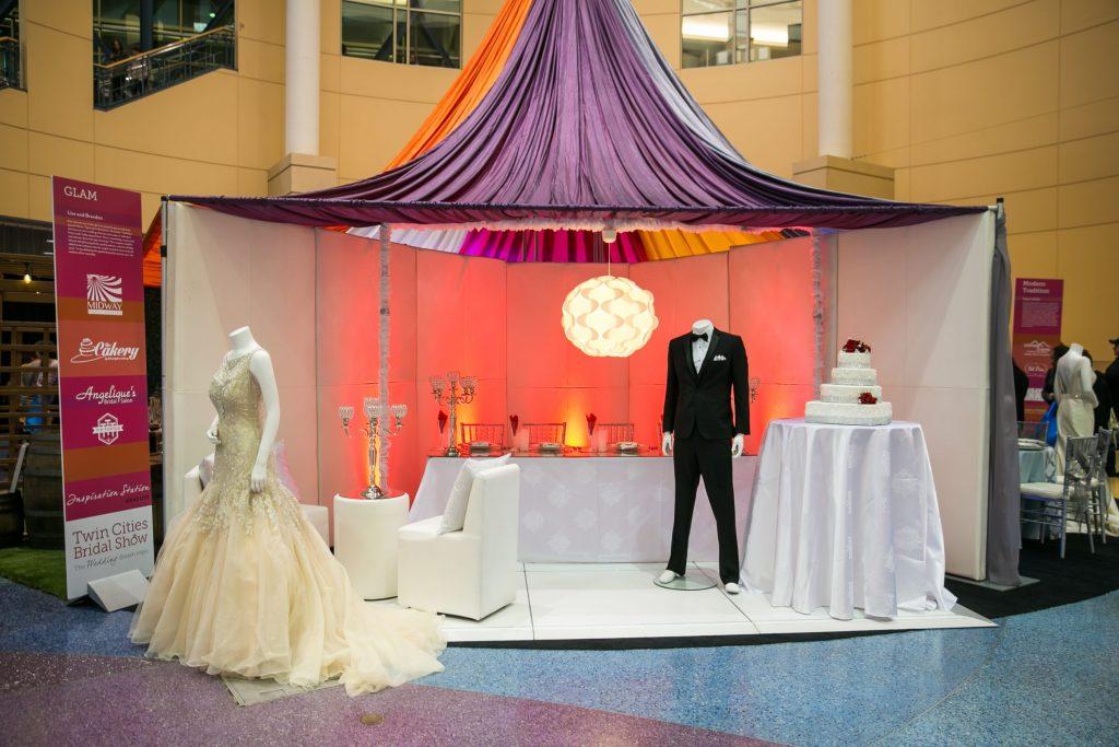 Mini wedding reception setup with white and red wedding decor
