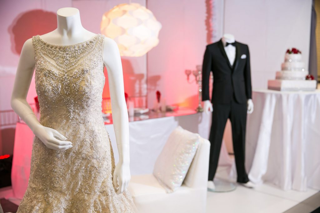 Beaded wedding dress and classic black and white tux