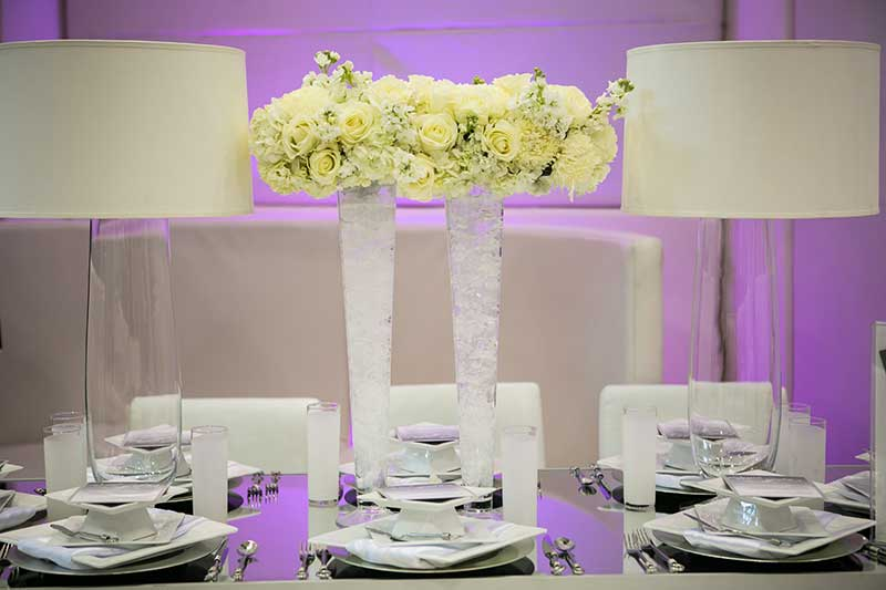 White and clear vase with yellow and white rose floral in wedding centerpiec3